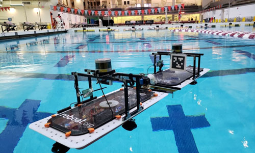 "MIT researchers putting their fleet of autonomous ""roboats"" to the test on the swimming pool"